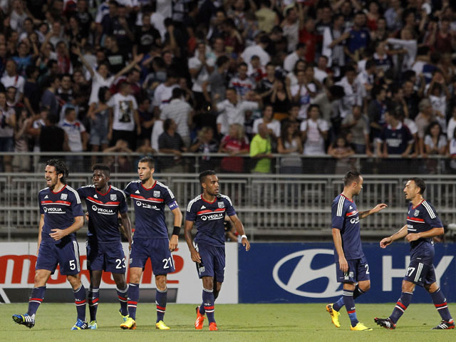 Lyon's Milan Bisevac celebrates scoring against Grasshopper Zurich with his teammates during their Champions League qualifying match on July 30, 2013
