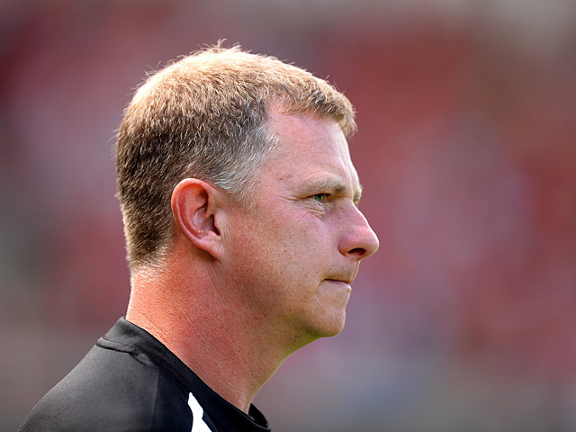 Huddersfield manager Mark Robins watches his team during the match against Nottingham Forest on August 3, 2013