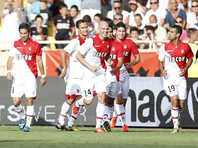 Monaco's Italian defender Andrea Raggi celebrates after scoring a goal during their friendly football match versus Tottenham on August 3, 2013