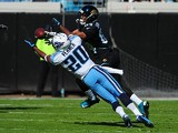 Alterraun Verner of the Tennessee Titans intercepts a pass intended for Cecil Shorts on November 25, 2012