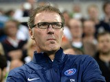 Paris Saint-Germain's head coach Laurent Blanc looks on during a friendly football match between PSG and Hammarby IF at the Tele 2 Arena on July 23, 2013