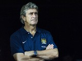 Manchester City manager Manuel Pellegrini on the touchline during a friendly match against Sunderland on July 27, 2013