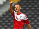 Fulham's Steve Sidwell celebrates after scoring the opening goal against Parma during a friendly match on August 10, 2013