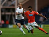 Blackpool's Tom Ince and Preston's Keith Keane battle for the ball during their League Cup match on August 5, 2013