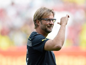 Borussia Dortmund head coach Juergen Klopp gestures during the match against Augsburg on August 10, 2013