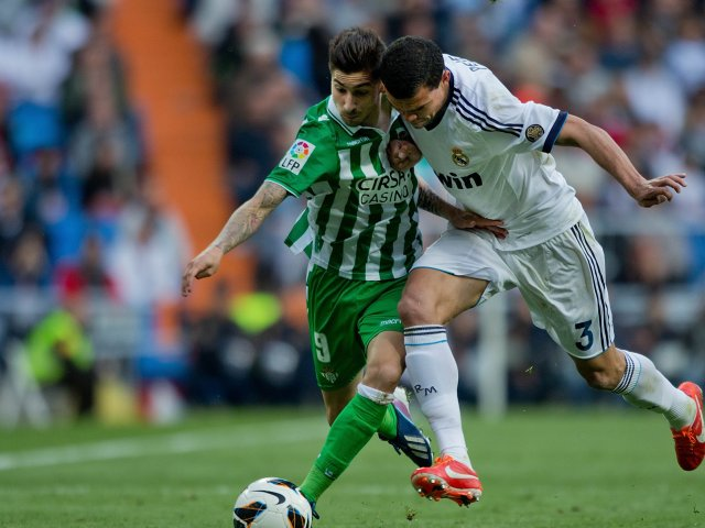 Alvaro Vadillo battles for possession with Real Madrid defender Pepe.