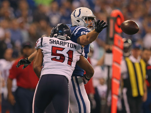 Darryl Sharpton of the Houston Texans tackles Coby Fleener of the Indianapolis Colts on December 30, 2012