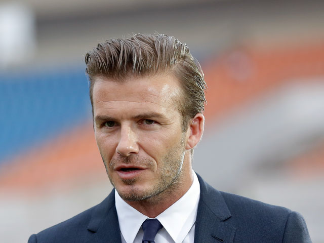 David Beckham looks on during his visit Hangzhou Huanglong Stadium on June 22, 2013