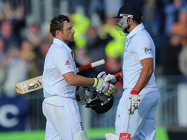 England's Ian Bell is congratulated by team mate Tim Bresnan after reaching his century on day 3 of the 4th Ashes Test on August 11, 2013