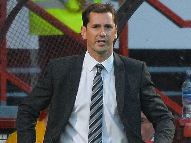 Dundee United manager Jackie McNamara reacts on the touchline during the match against Partick on August 2, 2013