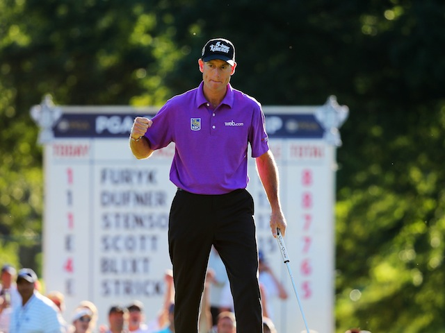 Jim Furyk celebrates a third-round birdie on the 17th at Oak Hill during the US PGA Championship on August 10, 2013
