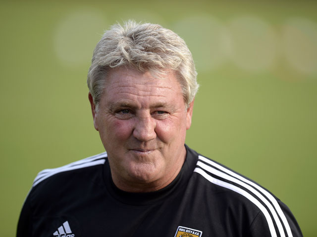 City manager Steve Bruce watches his team play North Ferriby during a pre-season friendly at the Eon Visual Media Stadium on July 15, 2013