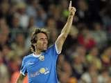 Almeria midfielder Corona celebrates a goal against Barcelona on April 9, 2011