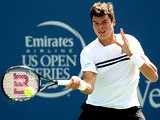 Milos Roanic in action against Janko Tipsarevic during the Western & Southern Open on August 14, 2013