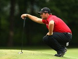 Patrick Reed lines up a putt on the first hole in the final round of the Wyndham Championship on August 18, 2013
