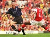 Patrick Vieira and Roy Keane challenge for possession.