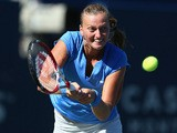 Petra Kvitova hits a return against Sorana Cirstea during the Rogers Cup on August 9, 2013
