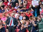 Arsene Wenger of Arsenal looks on as a fan behind makes his feelings known during the Barclays Premier League match between Arsenal and Aston Villa at Emirates Stadium on August 17, 2013