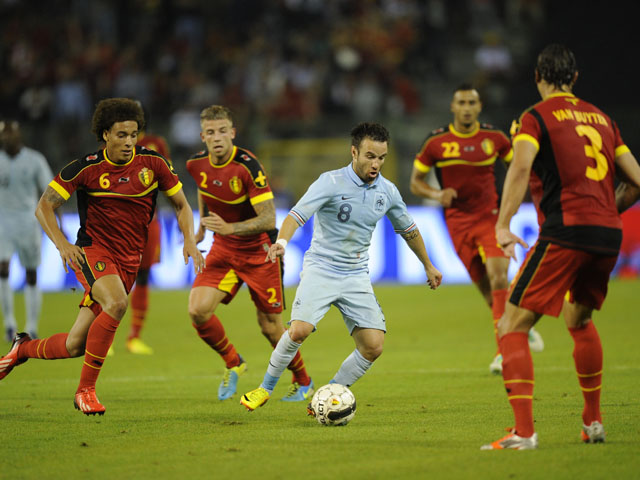 France's midfielder Mathieu Valbuena tries to get past Belgium's defense during the International Friendly on August 14, 2013