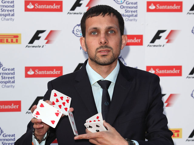 Magician Dynamo arrives for the F1 party at the Natural History Museum on July 6, 2011
