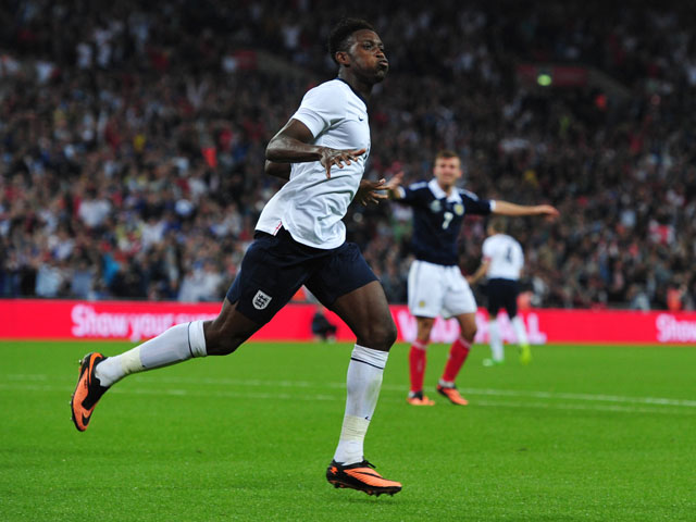 England striker Danny Welbeck celebrates scoring his team's second goal during the international friendly football match between England and Scotland at Wembley Stadium in London on August 14, 2013