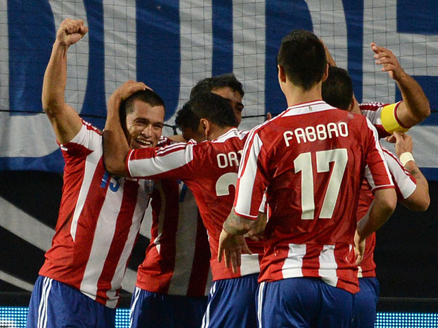 Paraguay´s players celebrate scoring during the friendly football match Germany vs Paraguay on August 14, 2013