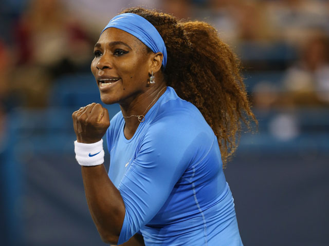 Serena Williams celebrates a point against Mona Barthel of Germany during the Western & Southern Open on August 15, 2013