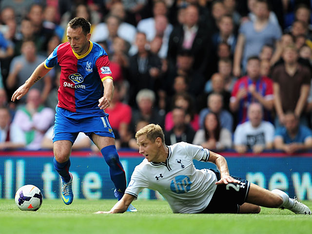 Palace's Stephen Dobbie beats Spurs' Michael Dawson to the ball on August 18, 2013