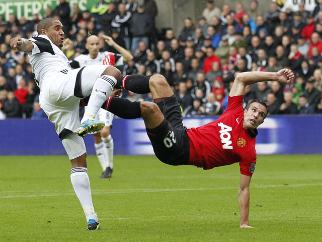 Manchester United's Dutch striker Robin van Persie scores the opening goal during the English Premier League football match between Swansea City and Manchester United at Liberty Stadium in Swansea, south Wales, on August 17, 2013