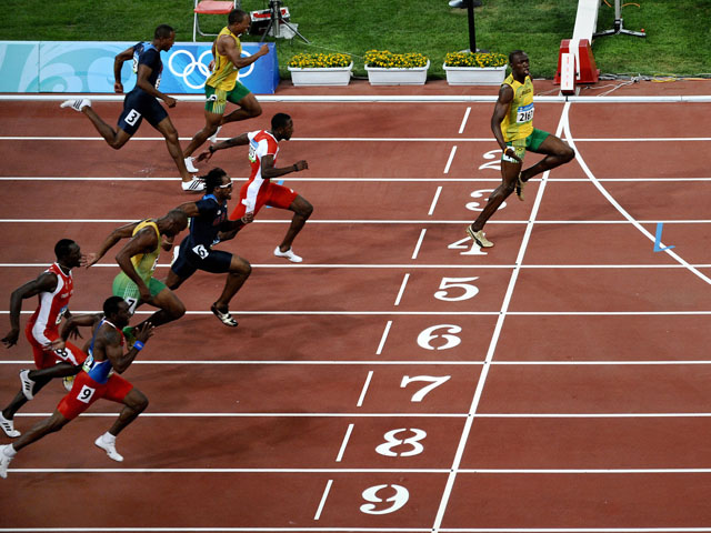 Jamaica S Usain Bolt Crosses The Finish Line To Win The