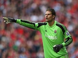 Asmir Begovic of Stoke City in action during the Barclays Premier League match between Liverpool and Stoke City at Anfield on August 17, 2013