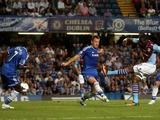 Christian Benteke of Aston Villa shoots past John Terry of Chelsea to score a goal to level the scores at 1-1 during the Barclays Premier League match between Chelsea and Aston Villa at Stamford Bridge on August 21, 2013