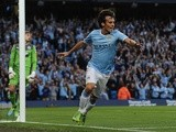 Man City midfielder David Silva celebrates opening the scoring against Newcastle on August 19, 2013