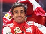 Fernando Alonso smiles as he prepares for the final qualifying session of the Belgium Grand Prix on August 24, 2013