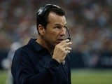 Houston Texans head coach Gary Kubiak calls a play during the second half of the preseason game against the Miami Dolphins at Reliant Stadium on August 17, 2013