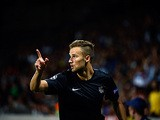 Real Sociedad's Haris Seferovic celebrates after scoring his team's second goal against Lyon on August 20, 2013