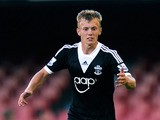 James Ward-Prowse of Southampton runs with the ball during a friendly match between RC Celta de Vigo and Southampton at Balaidos stadium on August 3, 2013