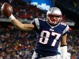 New England's Rob Gronkowski celebrates a TD against Miami on December 30, 2012