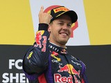 Sebastian Vettel celebrates on the podium after winning the Belgium Grand Prix on August 25, 2013