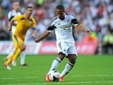 Swansea player Wayne Routledge gets in a shot at goal during the UEFA Europa League play-off first leg between Swansea City and FC Petrolul Ploiesti at Liberty Stadium on August 22, 2013