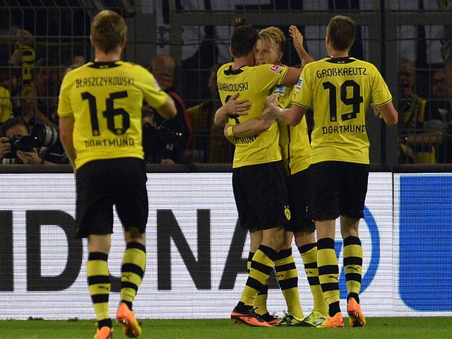 Dortmund's players celebrate scoring during the German first division Bundesliga football match Borussia Dortmund vs Werder Bremen in the German city of Dortmund on August 23, 2013