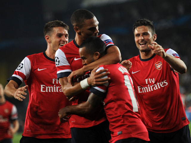 Arsenal's players celebrate their goal against Fenerbahce during their UEFA Champions League Play Off first leg match at Sukru Saracoglu Stadium in Istanbul on August 21, 2013