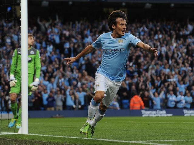 Man City midfielder David Silva celebrates opening the scoring against Newcastle on August 19, 2013