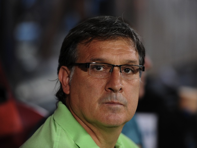 Barca boss Gerardo Martino in the dugout during the Super Cup game with Atletico Madrid on August 21, 2013