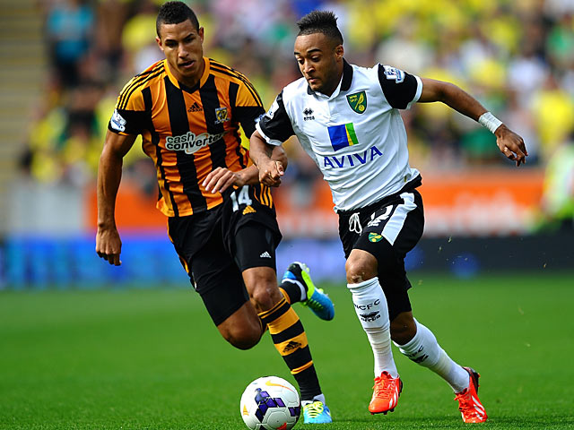 Hull's Jake Livermore and Norwich's Nathan Redmond battle for the ball on August 24, 2013