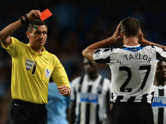 Ref Andre Marriner shows Steven Taylor a red card against Man City on August 19, 2013