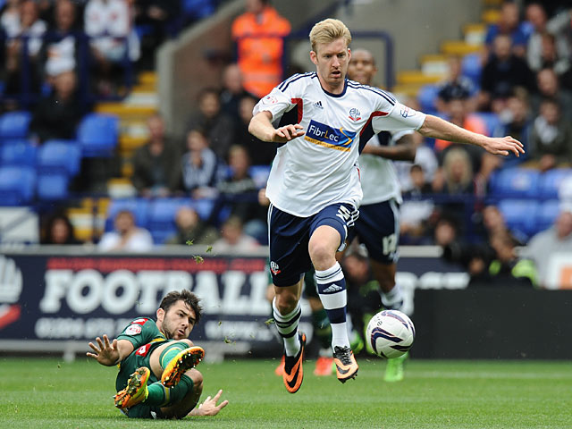 Bolton's Tim Ream and QPR's Charlie Austin battle for the ball on August 24, 2013