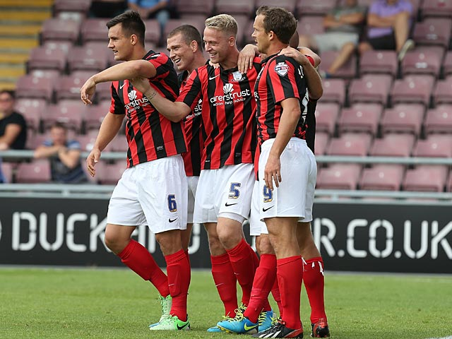 Preston's Tom Clarke is congratulated by team mates after scoring the opening goal against Coventry on August 25, 2013