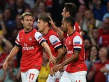 Arsenal's Aaron Ramsey is congratulated by team mates after scoring the opening goal against Fenerbahce during their Champions League play-off match on August 27, 2013