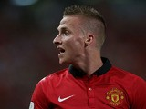 Alex Buttner #28 of Manchester United argues a call during the friendly match between Singha All Star XI and Manchester United at Rajamangala Stadium on July 13, 2013